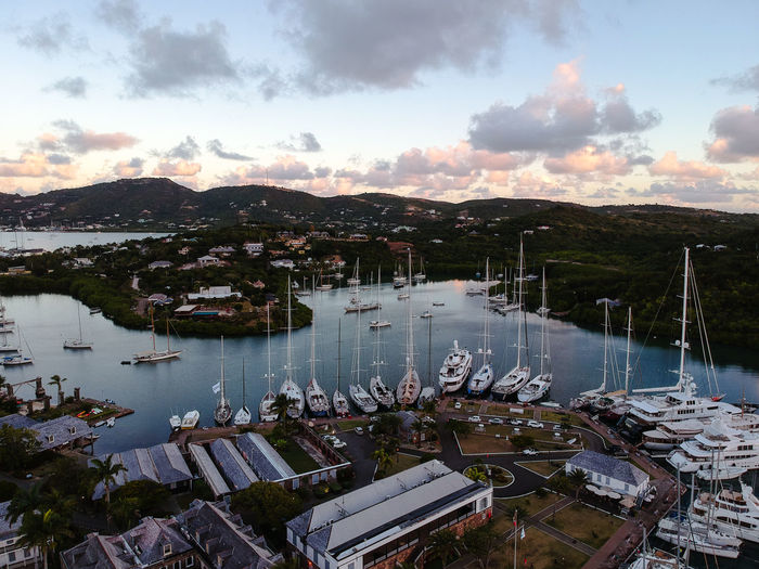 High angle view of boats moored at harbor during sunset