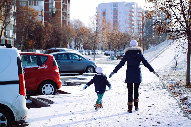Dancing in the snow... Winter Warm Clothing Cold Temperature Snow Ice Rink Winter Coat Snow Day Wintertime Winter In The City Fresh On Eyeem  Found On The Roll My Favorite Photo Leisure Activity Details Of My Life Urban City City Life Made In Romania Vscocam Dancing Child Fun Mother And Son Motherhood Adapted To The City The Street Photographer - 2017 EyeEm Awards Mobility In Mega Cities