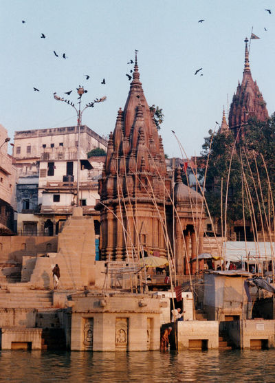 Varanasi 35mm print scan Ghats  Ghats On The Ganges India Indian Indian Culture  Indian People River View Riverside Sacred Places Varanasi, India Ganges, Indian Lifestyle And Culture, Bathing In The Ganges, Architecture Bird Building Exterior Built Structure Flock Of Birds Ghats Of Varanasi Riverbank Spirituality The Ganges River The Ganges,,, Travel Destinations Varanasi Varanasi India Water Waterfront