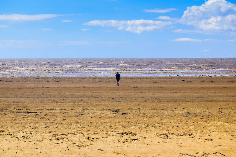 Sea Beach Land Water Sky Sand Nature Day Outdoors Beach Photography Horizon Over Water Leading Lines Space For Text Space For Copy Horizon Scenics - Nature Beauty In Nature Tranquil Scene Tranquility Cloud - Sky Real People Rear View One Person Non-urban Scene Alone Contemplation