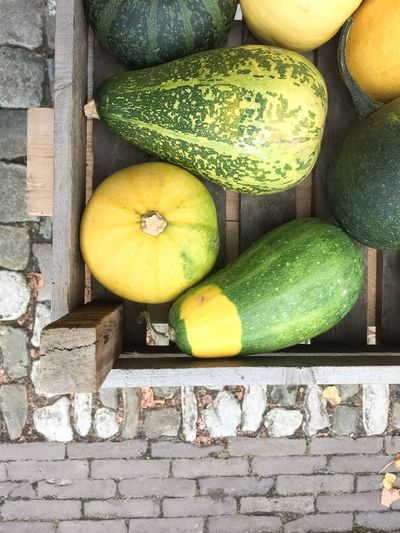 Directly above shot of squashes in crate for sale