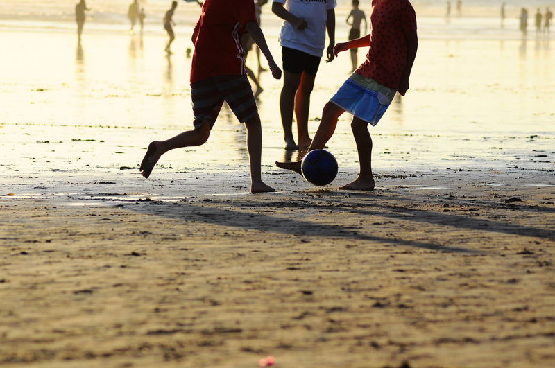 Beach Shore Light - Natural Phenomenon Light And Shadow Personal Perspective Soccer Shoe Low Section Sportsman Competition Competitive Sport Sports Team Sport Sports Clothing Soccer Playing Kids' Soccer Chasing Football Athleticism Soccer Player Kicking Soccer Ball Sports Jersey Exploring Fun