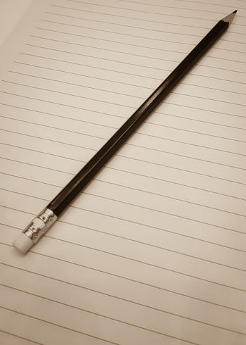 Black Pencil Put On Note Paper Sepia Tone Soft Brown Color Warm Feeling Classic Vintage Old Time Lecture Classroom Teacher And Student Exam Assignment Take Note Background Copy Space Memory Friendship Light And Shadow