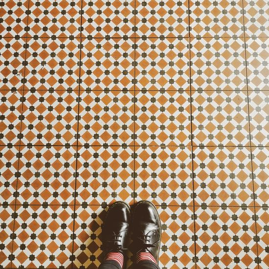 Low section of girl standing on tiled floor