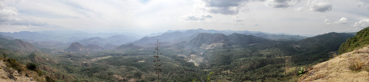 View of the Sierra Madre del Sur, in Mexico, from the top of a cliff. Beauty In Nature Cloud - Sky Day Freshness Landscape Mountain Mountain Range Nature No People Outdoors Panoramic Plant Scenics Sky Sunlight Tree