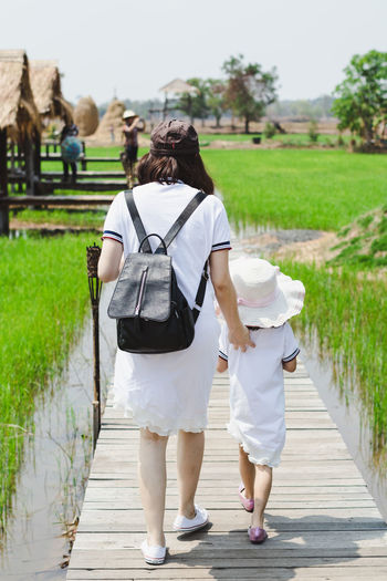 Rear View Full Length Real People Women Walking Adult Day Plant Casual Clothing Footpath People Two People Nature Lifestyles Leisure Activity The Way Forward Direction Togetherness Outdoors Green Color Hairstyle