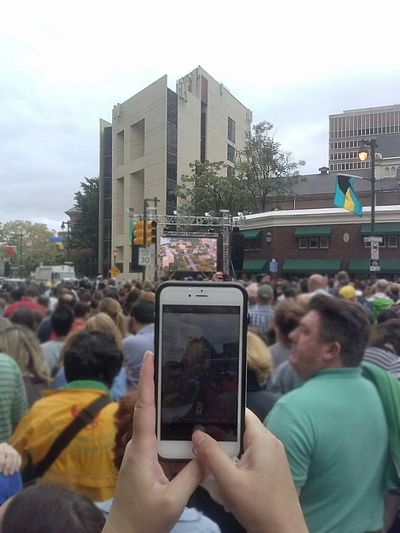 Phone Trapped - a reflection of me on her phone as I took a picture of the crowd...creepy but kinda cool ;) A picture of a reflection capturing a picture Reflection Urban Reflections Glass Reflection Interesting Pieces Taking Photos Check This Out Creative Photography From My Point Of View Philadelphia