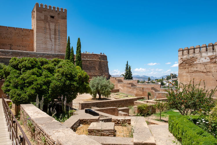 Alhambra De Granada  The Week on EyeEm Alhambra Ancient Ancient Civilization Architecture Blue Building Building Exterior Built Structure Day Fort Growth History Nature No People Old Outdoors Plant Sky Sunlight The Past Travel Destinations Tree Wall