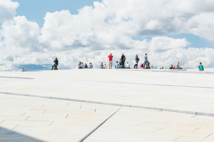 People At Oslo Opera House Against Sky