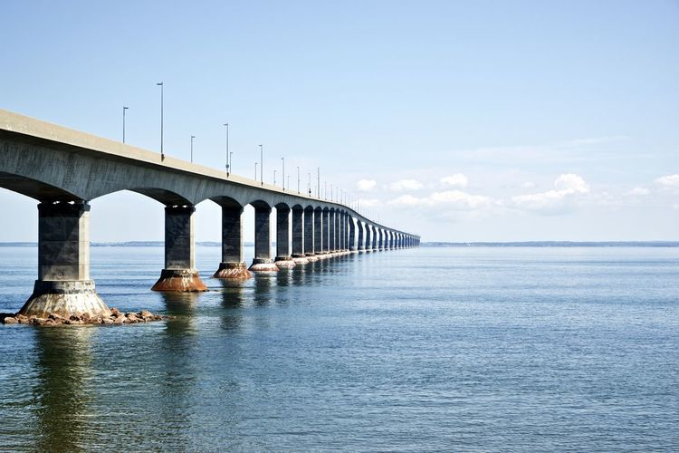 Canada: Confederation Bridge seen from New Brunswick side Confederation Bridge Daytime New Brunswick Road Architectural Column Architecture Beauty In Nature Bridge Bridge - Man Made Structure Built Structure Communication Connection Day Daylight Engineering Horizon Horizon Over Water Long Majestic Nature Outdoors Prince Edward Island Repetition Scenics - Nature Sea Sky Tranquility Transportation Water Waterfront