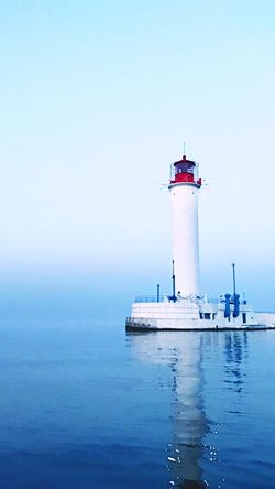 Water Guidance Lighthouse Sea Waterfront Tower Sky Direction Safety Nautical Vessel Built Structure Copy Space Clear Sky No People Transportation Day Building Exterior Security Outdoors Protection