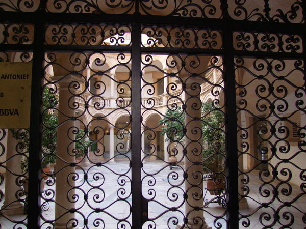 Wrought Iron Fence & Traditional Courtyard, Palma City Composition Mallorca Palma Palma De Mallorca SPAIN Sunlight And Shade Unusual Arch Architectural Feature Building Feature Capital City Close-up Courtyard  Full Frame No People Outdoor Photography Residential Building Residential Structure Traditional Feature Unusual Beauty Wrought Iron Design Wrought Iron Gate
