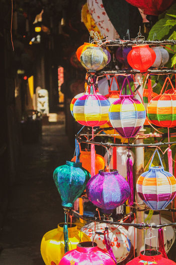 Close-up of lanterns hanging for sale at market stall
