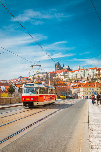Architecture Building Exterior Built Structure Cable City City Life Day Group Of People Incidental People Land Vehicle Men Mode Of Transport Nature Outdoors Prague Public Transportation Real People Road Sky Street Transportation