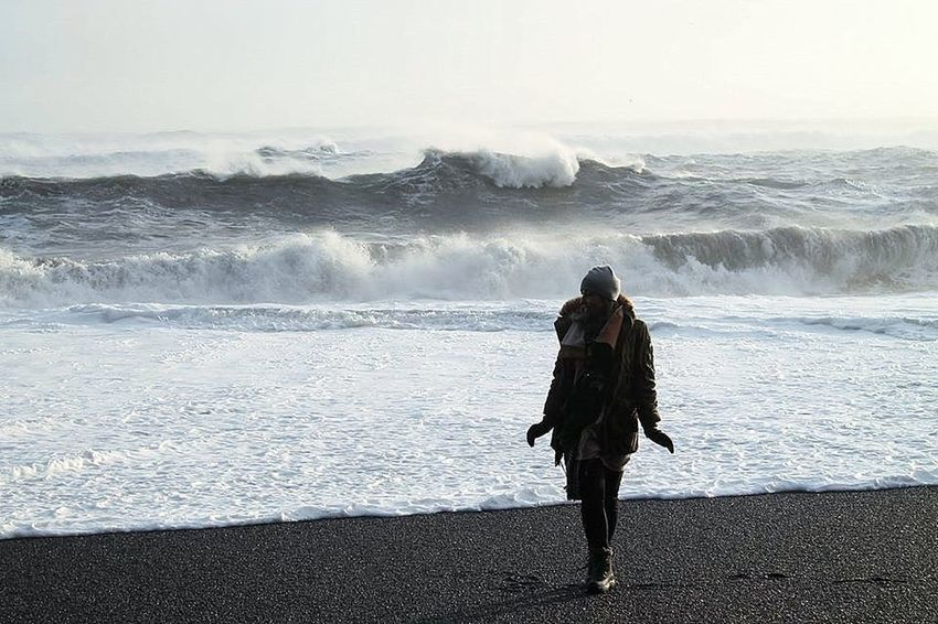 Adventure Beach Beauty In Nature Blacksand Blacksand Beach Dangerous Day Horizon Over Water Iceland Nature One Person One Woman Only Outdoors Power In Nature Rear View Sea Standing Travel Destinations Vacations Wave Wave Waves, Ocean, Nature Wilderness Winter