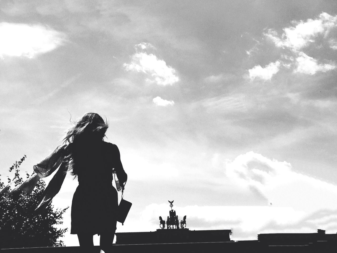 Silhouette woman walking against the sky