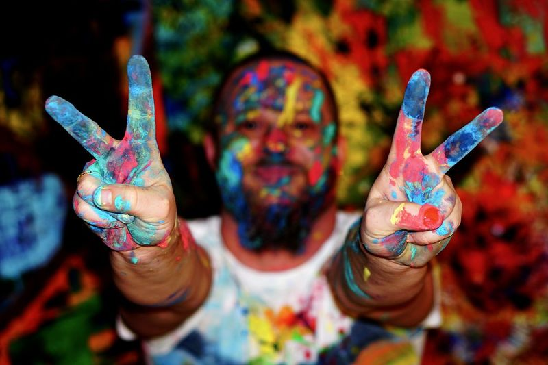 Close-up of hand painting peace sign