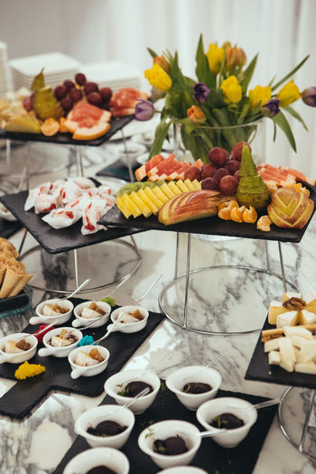 Catering Food - Assortment Food And Drink Baked Baked Pastry Item Cake Catering Choice Crockery Decoration Dessert Food Food And Drink Food Styling Freshness High Angle View Indoors  Indulgence No People Plate Ready-to-eat Still Life Sweet Sweet Food Table Temptation Variation