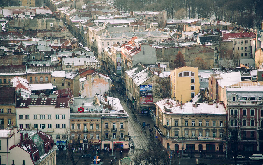 Aereal view of Lviv - popular Ukrainian city for tourist attractions and beautiful architecture Aereal Photo Aereal View Architecture Building Exterior Built Structure City Cityscape Cold Season Day Europe Fly Flying High Lviv Lvov Outdoors Roof Snow Tourism Tourist Tourist Attraction  Tourist Destination Ukraine Ukrainian  Weather Change Winter