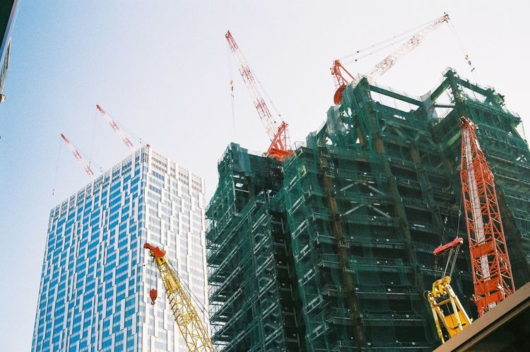 Film Photography Architecture Built Structure Construction Site Building Exterior Development Low Angle View Crane - Construction Machinery Skyscraper Growth Day Outdoors City Building - Activity Clear Sky No People Sky Colour Your Horizn