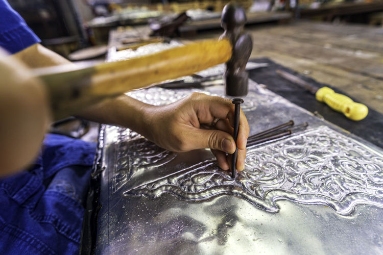 Silverware making. thai craftman are making silverware. the original of the silver craftsmen.