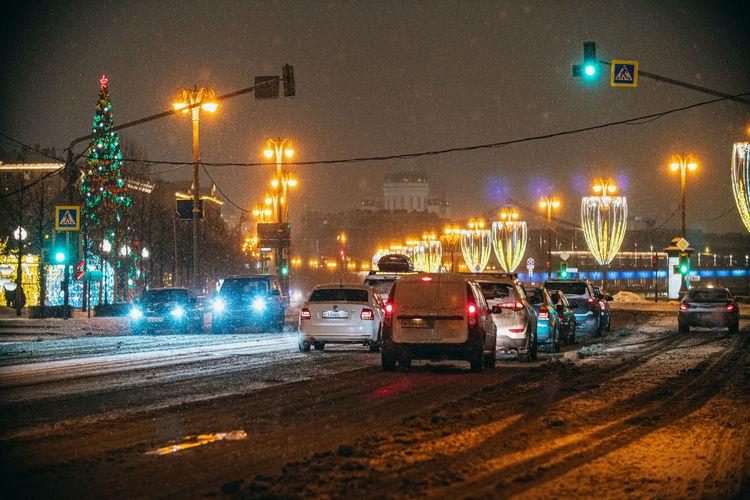 Traffic on city street at night