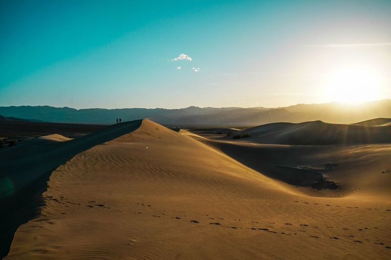 Walking through the dunes at sunrise in the desert