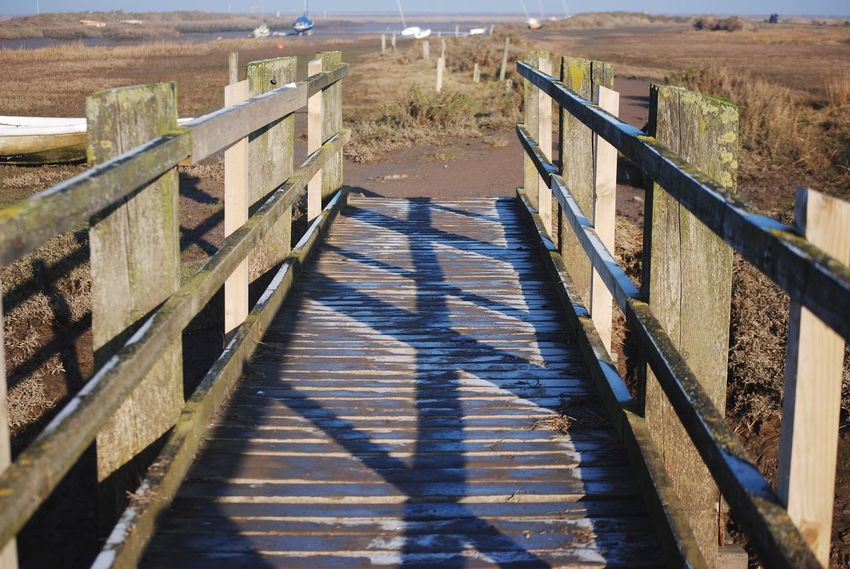 Wood - Material Boardwalk Railing Sunlight The Way Forward Outdoors Day Nature Picket Fence No People Beauty In Nature Wood Paneling Bridge Blakeney Marsh