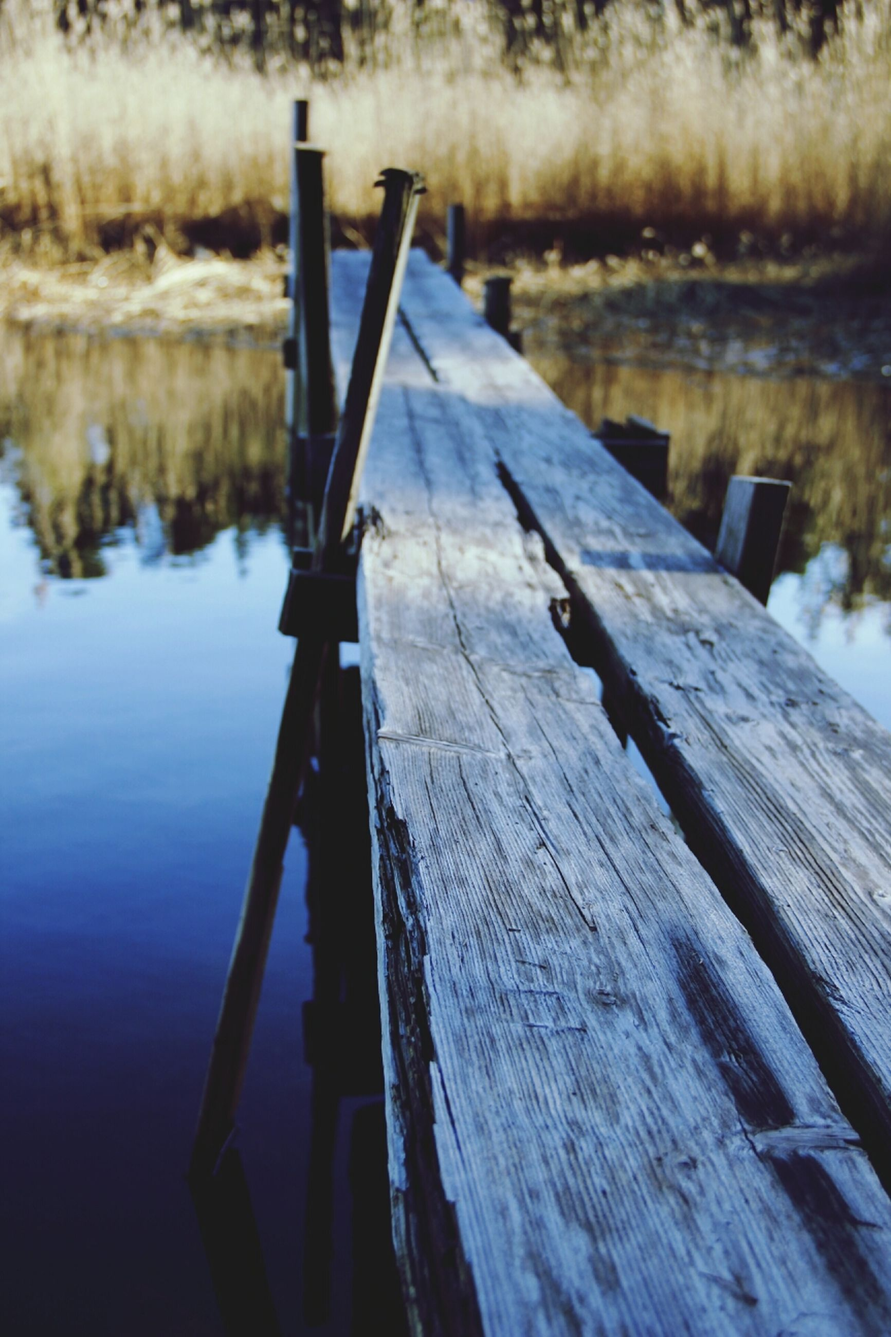 water, lake, wood - material, reflection, pier, nautical vessel, rope, river, wooden, wood, wooden post, boat, focus on foreground, day, close-up, nature, tranquility, outdoors, jetty, rippled