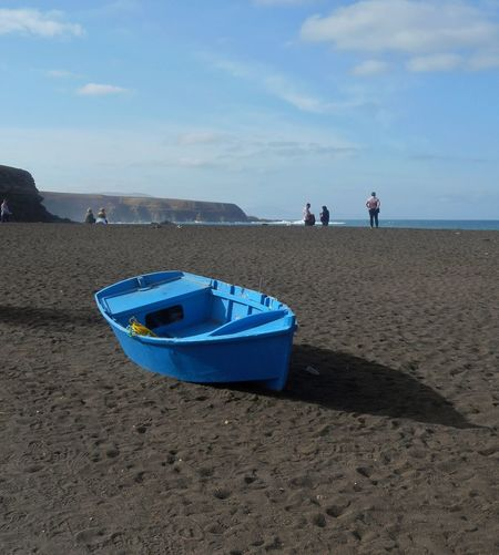 Black Beach Sand Beach Sand Shadow Outdoors Sky Sea Only Men People Day Blue Adult Vacations Nature Full Length Adults Only One Man Only Water Animal Themes Fuerteventura canary Islands