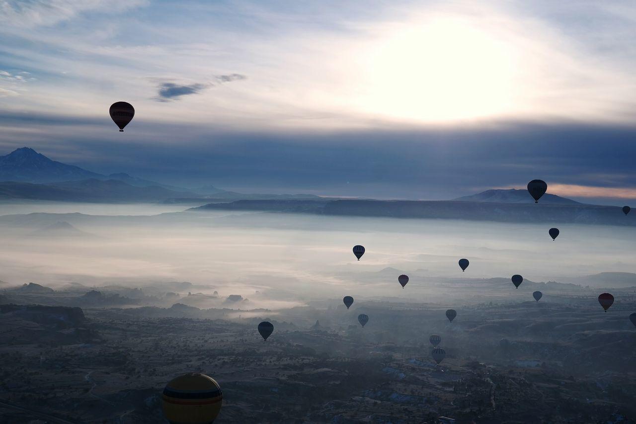 Hot air balloons flying at cappadocia during sunset