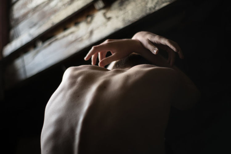 Human Body Part Indoors  Body Part Adult Real People One Person Skin Skinny Depression - Sadness Depression Depressed Mood Human Hand Shirtless Hand Human Skin Touching Human Back
