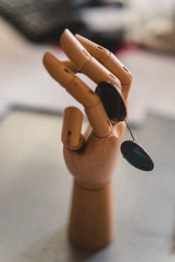 Craft Items Craftsmanship  Vintage Craft Arts And Crafts Focus On Foreground Human Hand Close-up Human Representation Hand Human Body Part Representation Art And Craft Body Part One Person Indoors  Creativity Finger Human Finger Day Figurine  Real People Social Issues Male Likeness Nail Human Limb