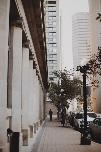Architecture Built Structure City Building Exterior Full Length City Life Walking Rear View Tall - High Skyscraper Street Tree Office Building Street Light Men Modern Building Story Urban Lifestyle Architecture City Winnipeg Downtown Full Frame Day The Way Forward