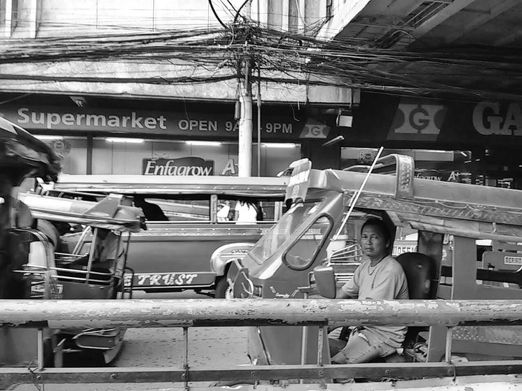 Tangled. Street Photography Eyeem Philippines Streetphoto_bw Get Moving Monochrome Blackandwhite Bw_ Collection Authentic Moments Commuting RePicture Travel Capture The Moment EyeEm Cagayan De Oro Eyeem CDO