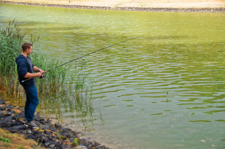 Fishing Net Beauty In Nature Casual Clothing Day Fish Fisherman Fisheye Fishing Full Length Hobby Lake Leisure Activity Lifestyles Men Nature One Person Outdoors Plant Real People Side View Standing Tranquility Water