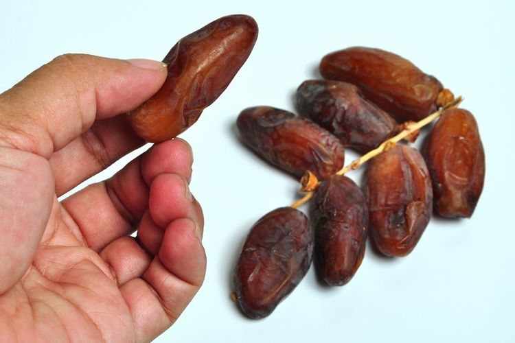 Kurma - Dates Palm Fruits Human Hand Human Body Part People Food And Drink Studio Shot Food Close-up Healthy Eating Freshness Fasting Ramadhan Fasting Month Food And Drink Freshness Kurma Ramadhan Dates Fruit Dates Palm Glucose Fasting Sweet Food Puasa Fruits And Vegetables White Background Fruit Moslem