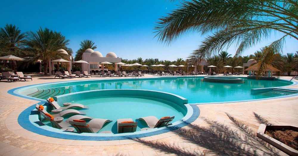 Hotel la Gazelle D'or Oued Souf-Algerie Palm Tree Swimming Pool Water Tourist Resort Vacations Tree Blue Luxury Day Swimming Outdoors Clear Sky Luxury Hotel Sky No People Nature Hotel Algérie Algeria Photography EyeEm Algeria Sahara Gazelle D'or Oued Souf Sahara Of Algeria