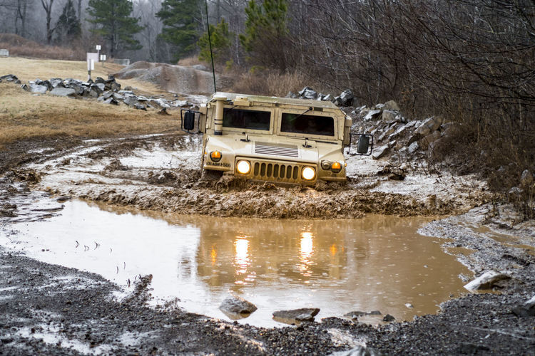 Playing in the mud Army Humvee Army Training  Water Land Vehicle Sky Puddle Muddy