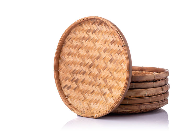 Close-up of wicker basket on white background