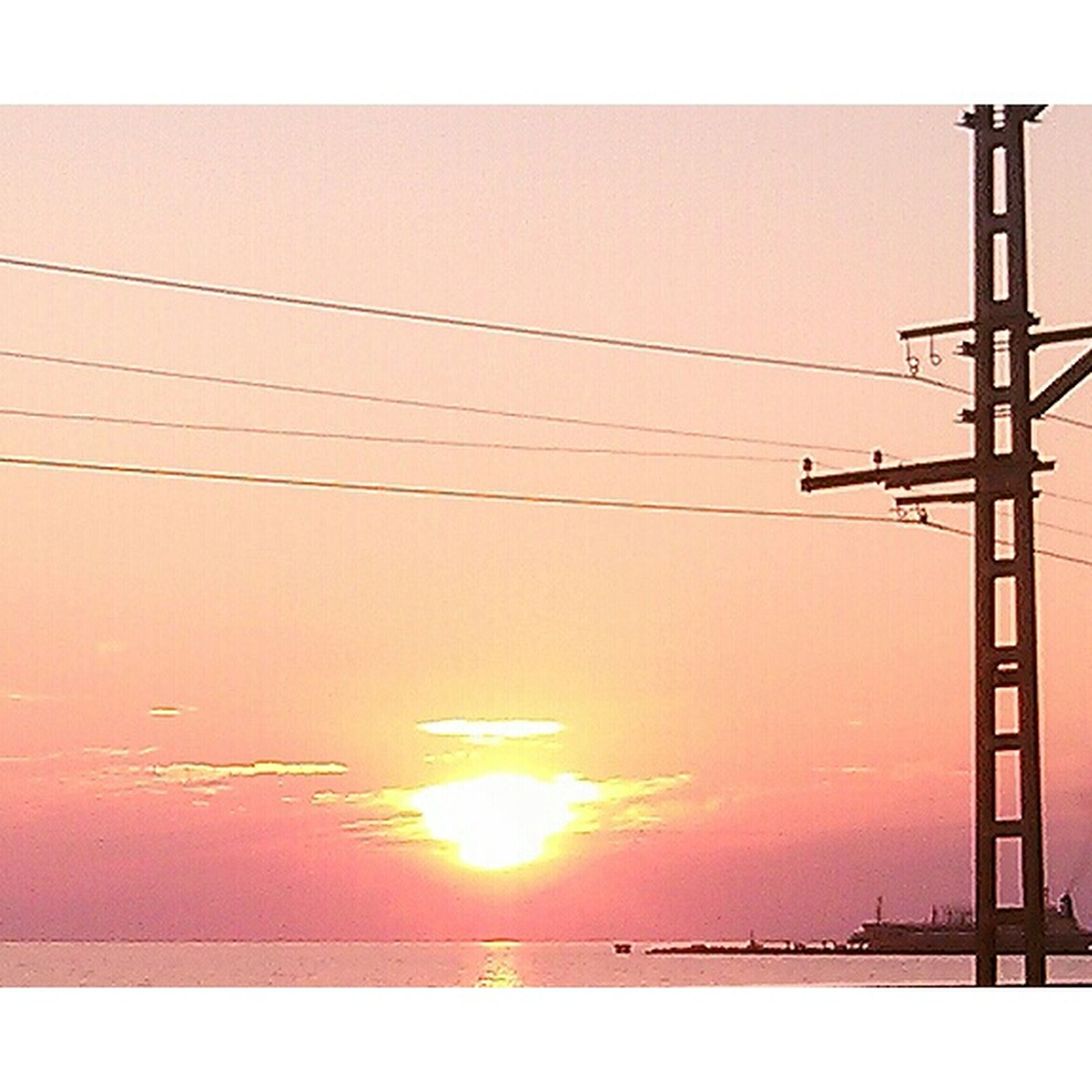 power line, power supply, electricity, electricity pylon, sunset, fuel and power generation, cable, connection, low angle view, sun, technology, transfer print, sky, clear sky, power cable, auto post production filter, sunlight, built structure, orange color, outdoors
