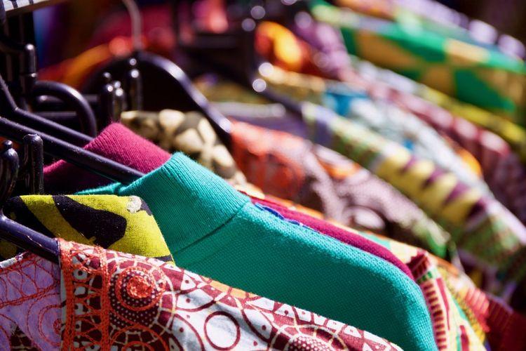Full frame shot of kurtas hanging on rack in market for sale