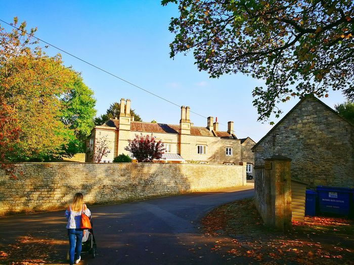 Architecture History Outdoors People Building Exterior Tree Built Structure Sky Adult Day Adults Only Only Men Cotswolds Cotswold Stone Cotswold Wall Georgian Architecture Posh Houses Posh House Georgian House High Wall High Stone Wall High Cotswold Wall High Cotswold Wall With Coping Tall Chimneys Georgian Building