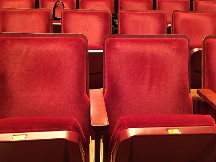 Full frame shot of red seats in movie theater