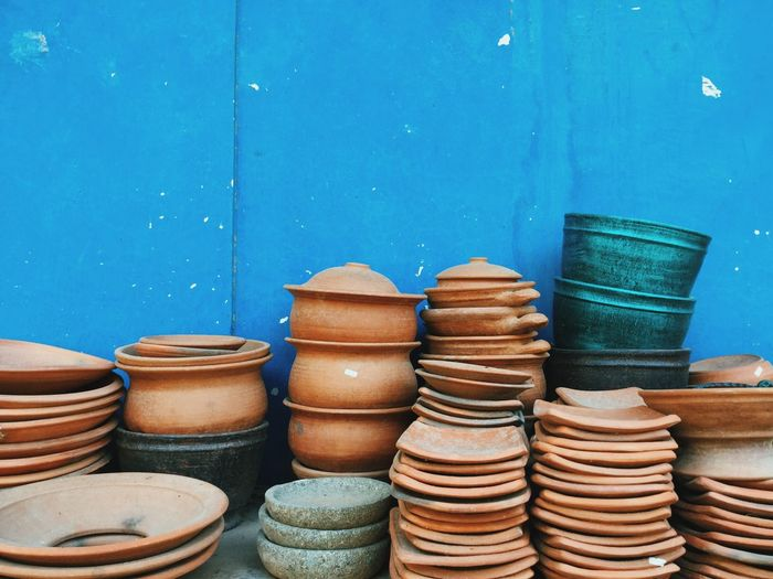 Clay Bowls For Sale Against Blue Wall