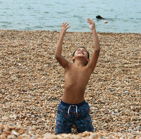 EyeEm Selects One Boy Only Children Only Arms Raised Child Childhood Leisure Activity Sea Beach Summer Outdoors Happiness Happy Time Pebbles On A Beach Pebble Beach English Beach English Beach Scene Wave Sea Life Waterfront Child Photography Childhood Memories Happines Happiness Is.... Happiest Moment