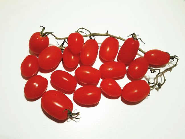 Fresh sweet grape tomatoes with vine Tomatoes Grapes Cherry Red Fruit Vegetable Eat Food Selection Choice Diet Gardening Vine Sweet Healthy Bright Isolated White Background White Background Red Studio Shot Fruit Healthcare And Medicine Nutritional Supplement Close-up Food And Drink Display