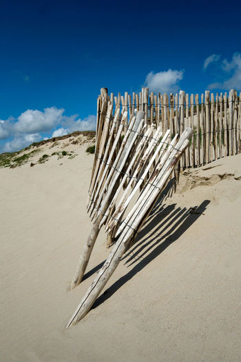 Arid Climate Beach Beauty In Nature Cloud - Sky Day Desert Ecosystem  Fence Fence Posts Fencepost Landscape Nature No People Outdoors Sand Sand Dune Sandy Sandy Beach Sandy Beaches Shadow And Light Sky Space For Text Tranquil Scene Weathered Fence Weathered Wood EyeEmNewHere