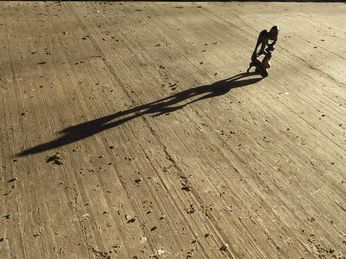 on the road - migration - Berlin the city for a new beginning and hope - an adventure African Art Leaving Behind The Still Life Photographer - 2018 EyeEm Awards Brown Chain Close-up Concrete Floor Day High Angle View Kneeling Down Metal Nature No People Outdoors Refugeeswelcome Sculpture In The City Shadow Single Object Still Life Sunlight Sunny Textured  Thinking About Life Wood Wood - Material