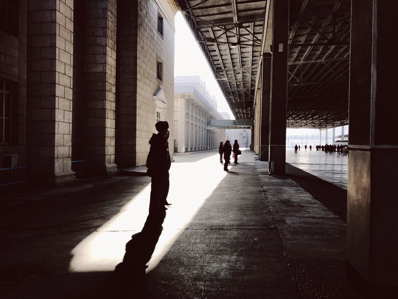 Silhouette of people at train station